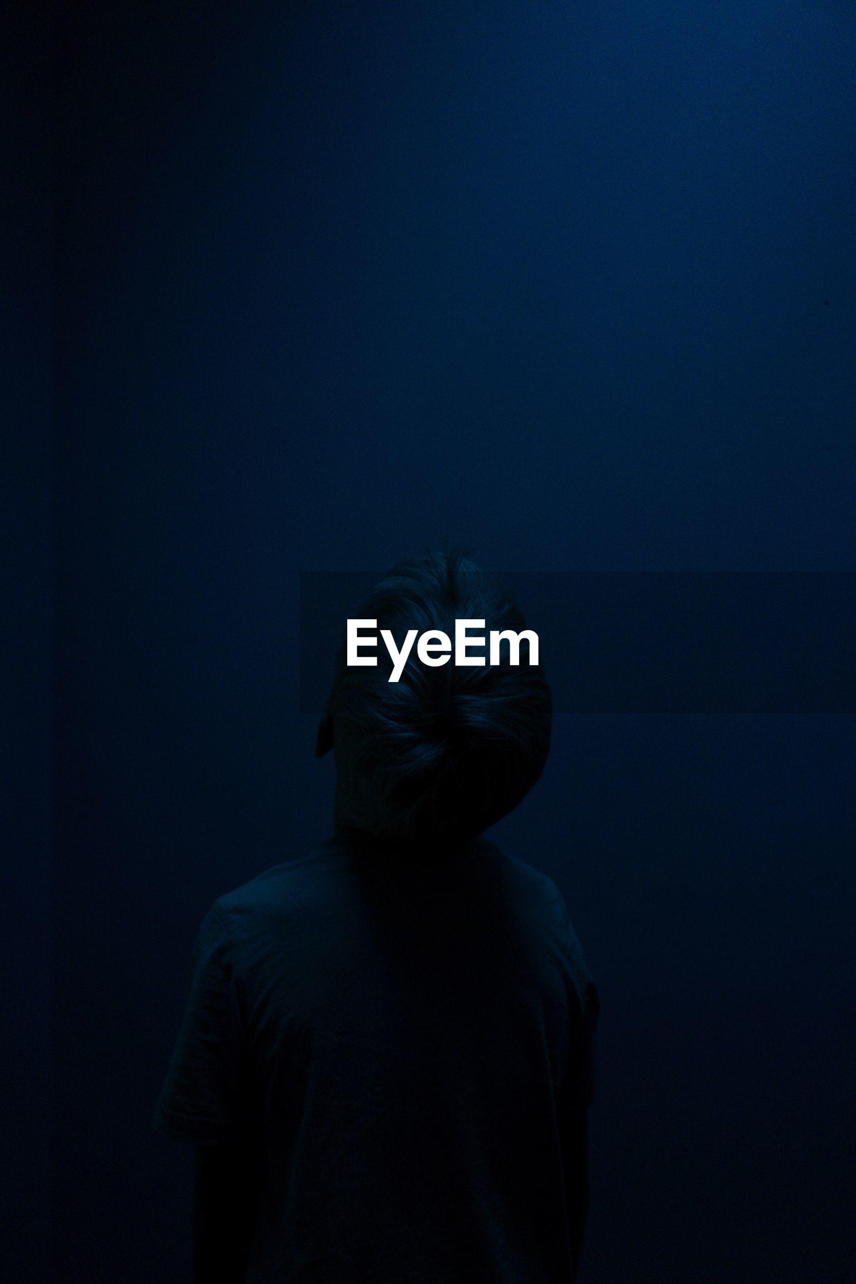 Boy in dark at night
