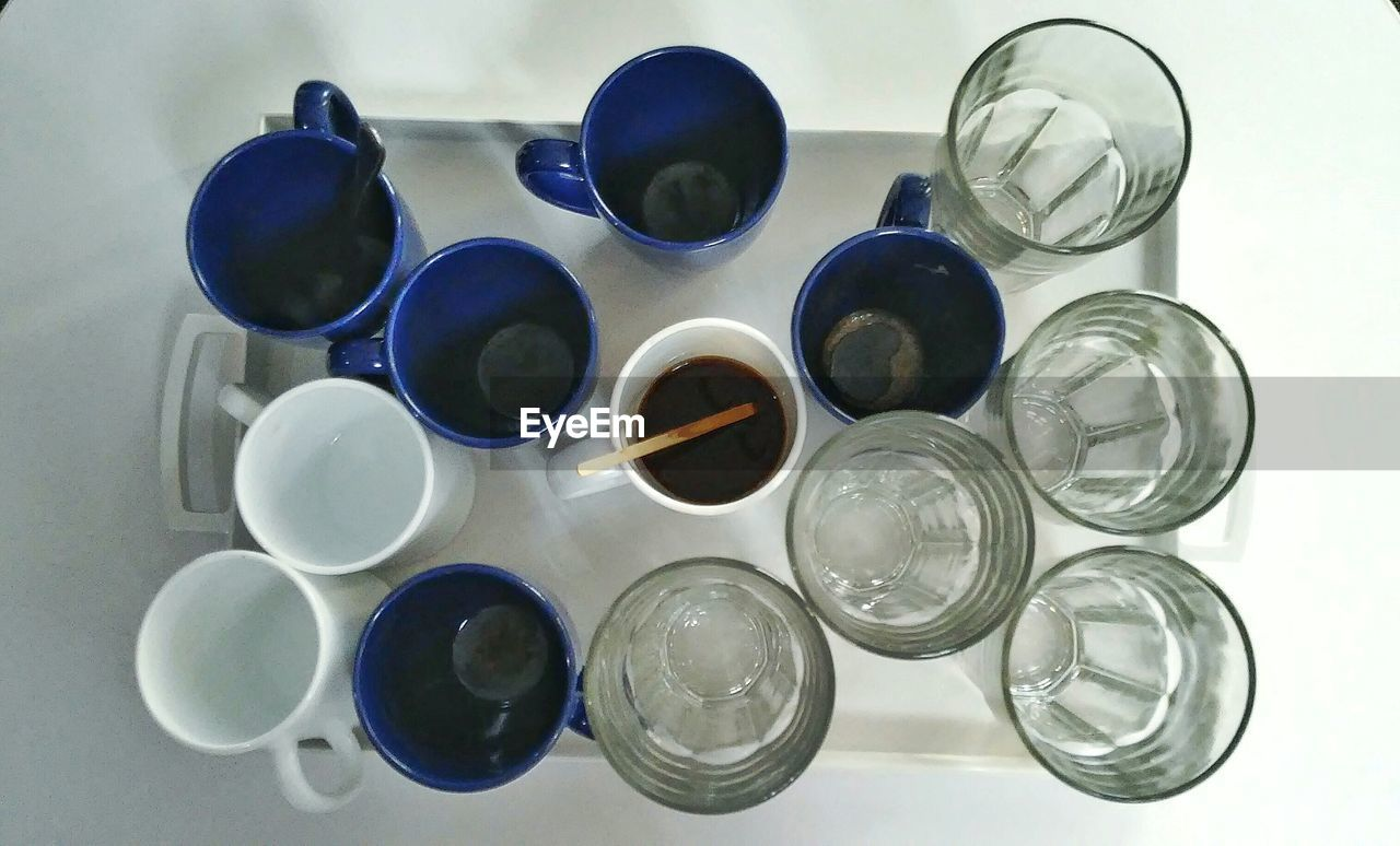 Directly Above View Of Cups And Glasses In Tray