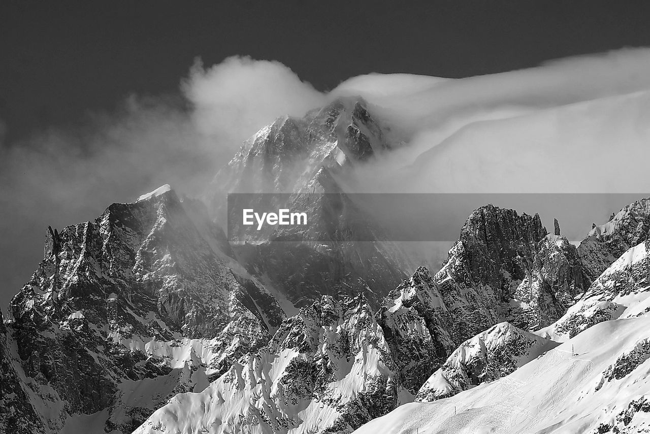 mountain, scenics - nature, beauty in nature, snow, winter, cold temperature, tranquil scene, mountain range, non-urban scene, tranquility, environment, nature, landscape, day, geology, sky, cloud - sky, snowcapped mountain, covering, mountain peak, no people, outdoors, formation, volcanic crater, power in nature