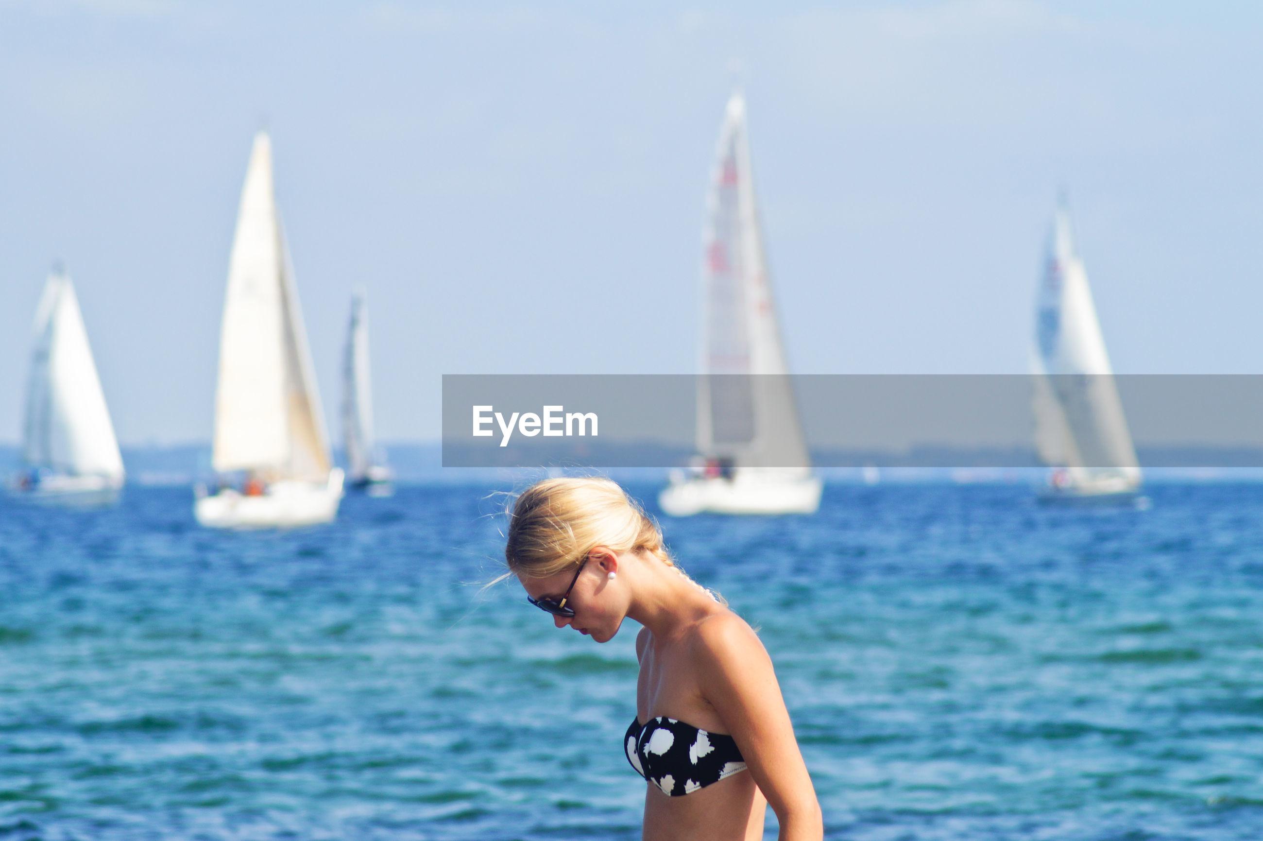 Woman Wearing Bikini Top Against Sea