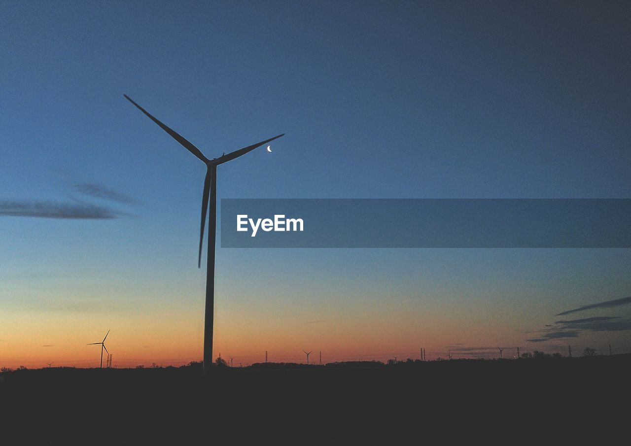 wind power, wind turbine, alternative energy, environmental conservation, fuel and power generation, windmill, renewable energy, industrial windmill, technology, sunset, outdoors, nature, silhouette, low angle view, field, no people, sky, traditional windmill, beauty in nature, scenics, rural scene, day