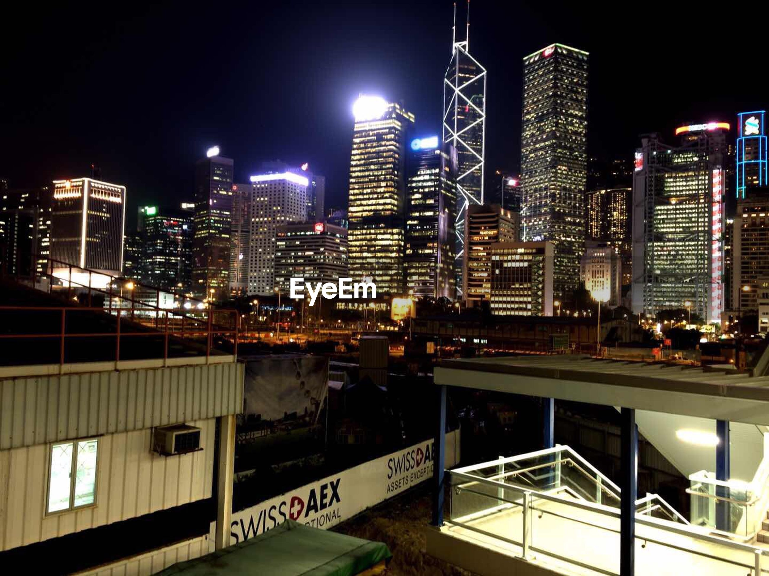 building exterior, city, architecture, skyscraper, built structure, night, cityscape, illuminated, tall - high, modern, office building, tower, urban skyline, financial district, city life, capital cities, tall, downtown district, building, development