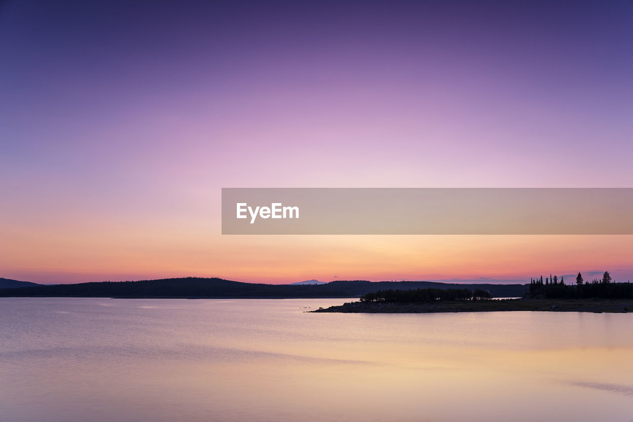 sky, sunset, water, scenics - nature, beauty in nature, tranquil scene, tranquility, waterfront, orange color, no people, sea, nature, idyllic, silhouette, copy space, outdoors, architecture, cloud - sky, purple, romantic sky
