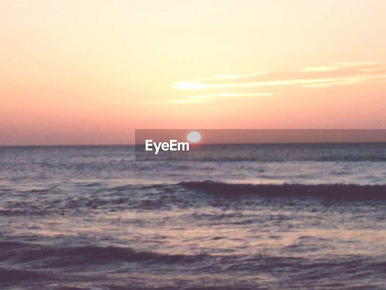 sea, sunset, scenics, beauty in nature, horizon over water, nature, tranquility, tranquil scene, sun, idyllic, sky, water, beach, no people, outdoors, horizon
