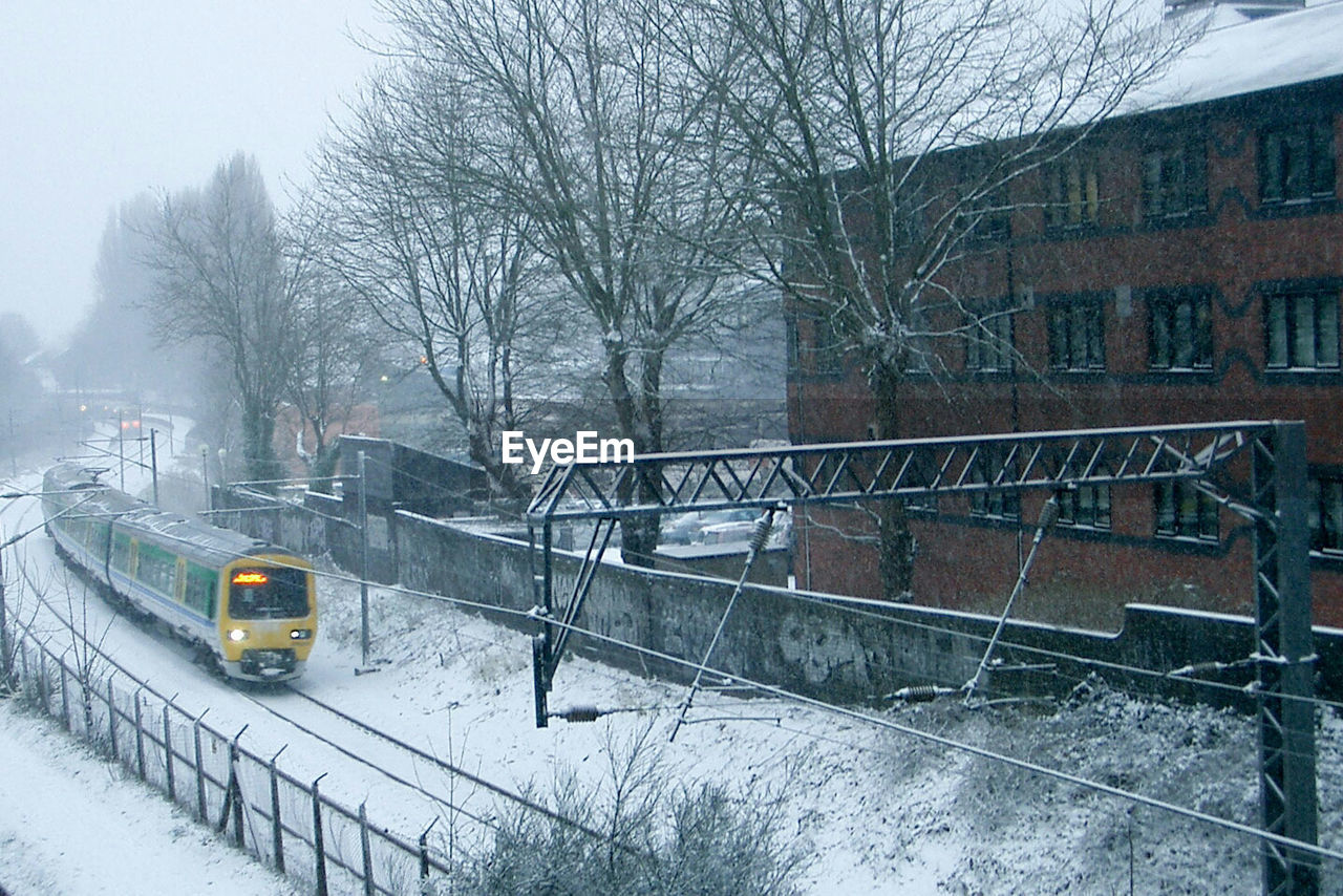 High angle view of train amidst snow covered field