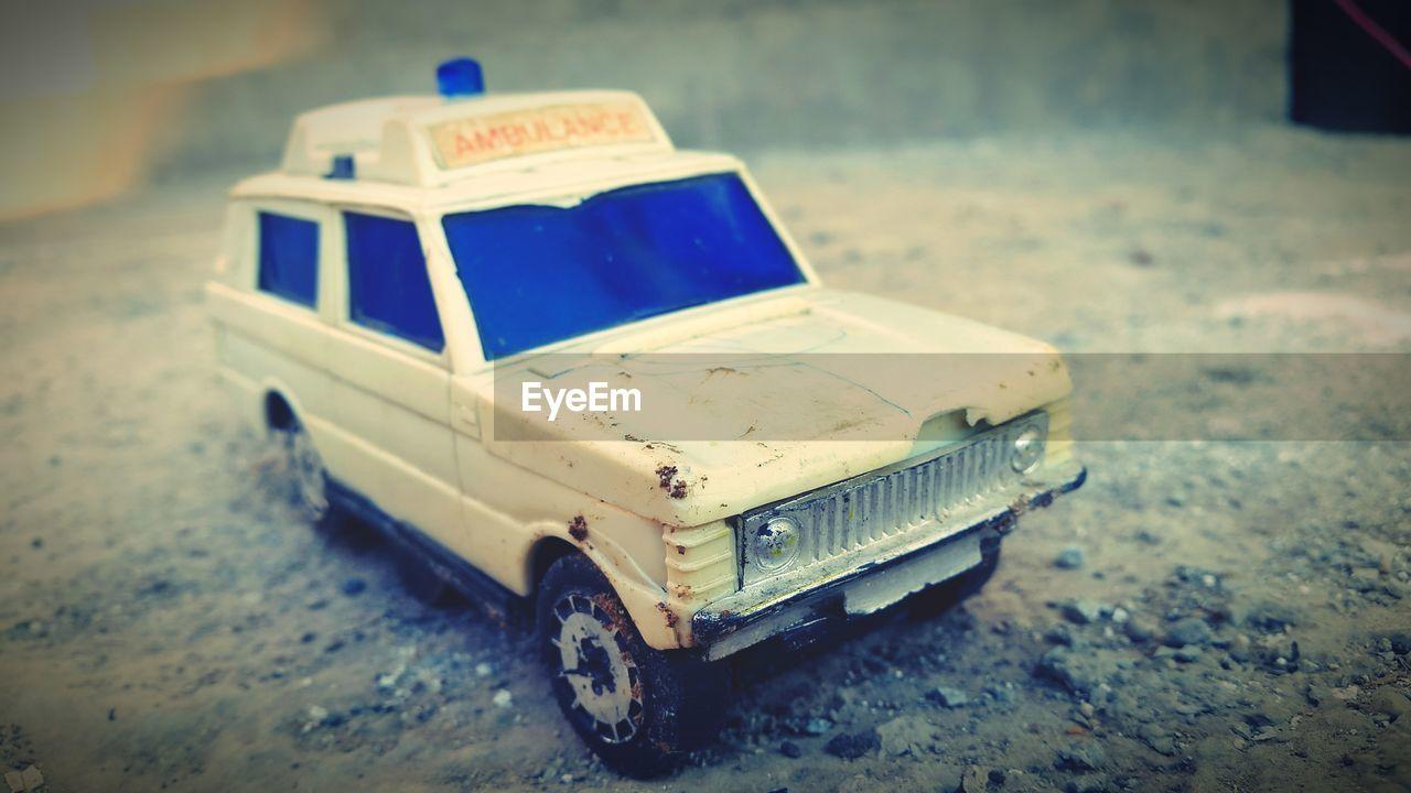 Close-up of ambulance toy on street