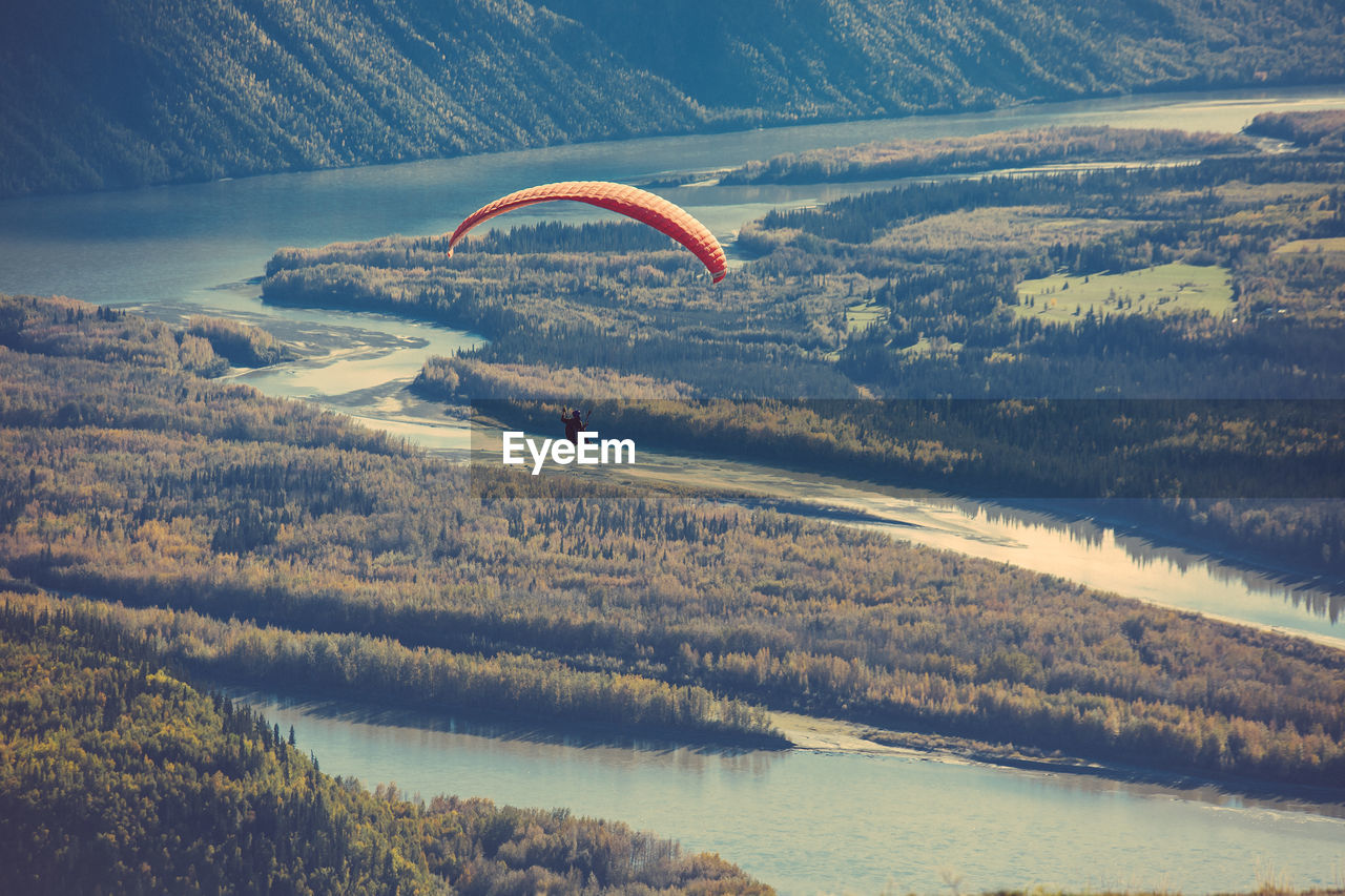 High Angle View Of Hot Air Balloon Flying Over Landscape