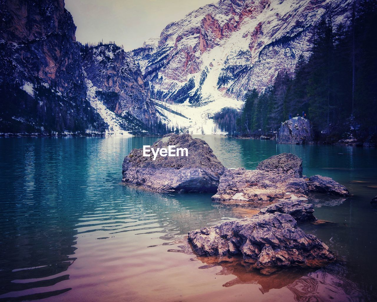 water, beauty in nature, scenics - nature, tranquility, tranquil scene, mountain, reflection, rock, lake, waterfront, rock - object, nature, solid, non-urban scene, rock formation, idyllic, no people, mountain range, sky, outdoors, formation