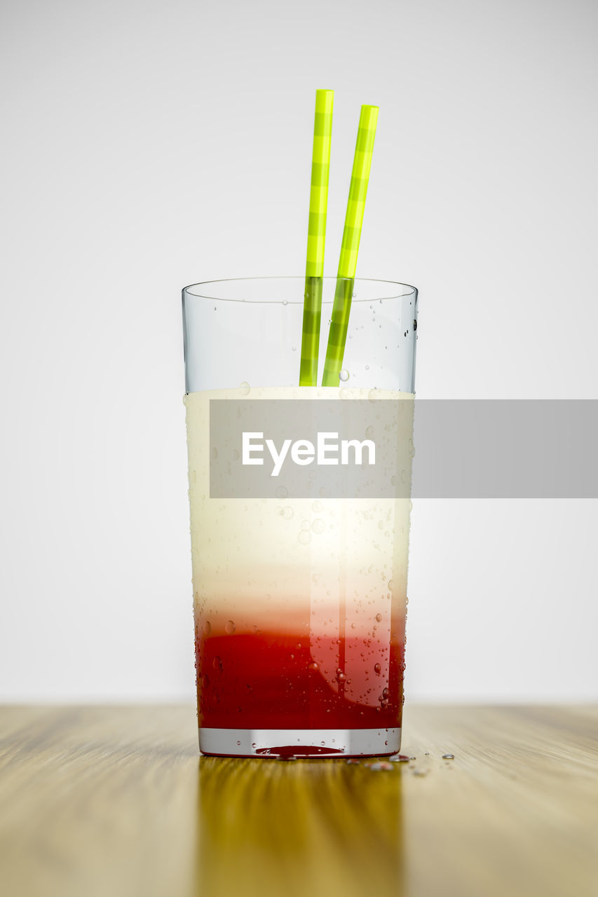 drink, drinking glass, glass, refreshment, food and drink, white background, household equipment, indoors, studio shot, freshness, still life, table, no people, glass - material, close-up, transparent, drinking straw, container, food