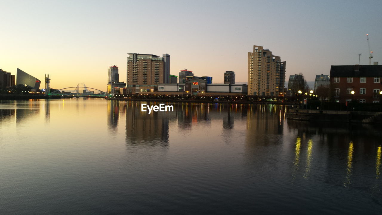 water, building exterior, architecture, built structure, waterfront, sky, city, reflection, building, river, nature, no people, clear sky, office building exterior, illuminated, landscape, urban skyline, cityscape, outdoors, modern, skyscraper