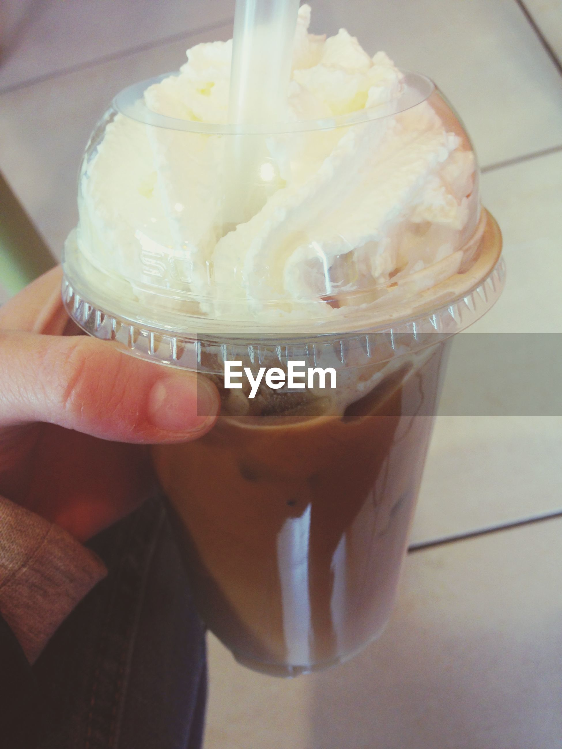 person, food and drink, indoors, holding, freshness, lifestyles, part of, sweet food, cropped, refreshment, food, drink, unrecognizable person, close-up, personal perspective, human finger