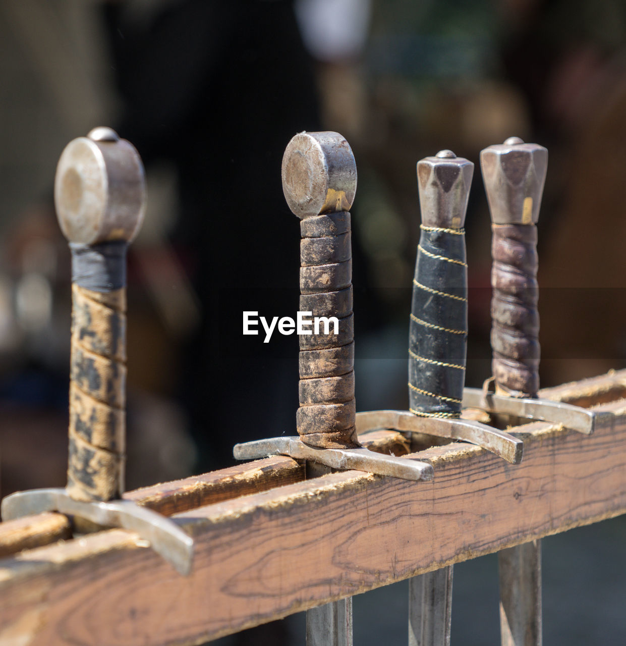 Close-up of rusty work tools hanging on wood