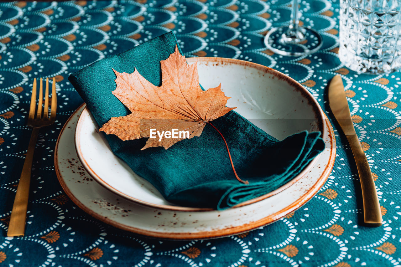 High angle view of maple leaf on table