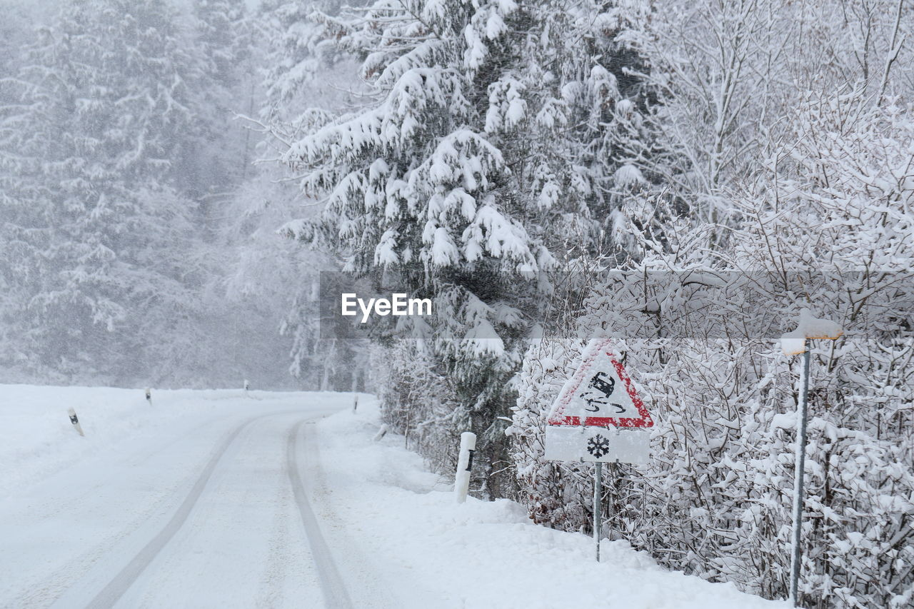 snow, cold temperature, winter, tree, road, transportation, plant, beauty in nature, nature, land, direction, sign, no people, snowing, covering, scenics - nature, frozen, white color, the way forward, outdoors, extreme weather