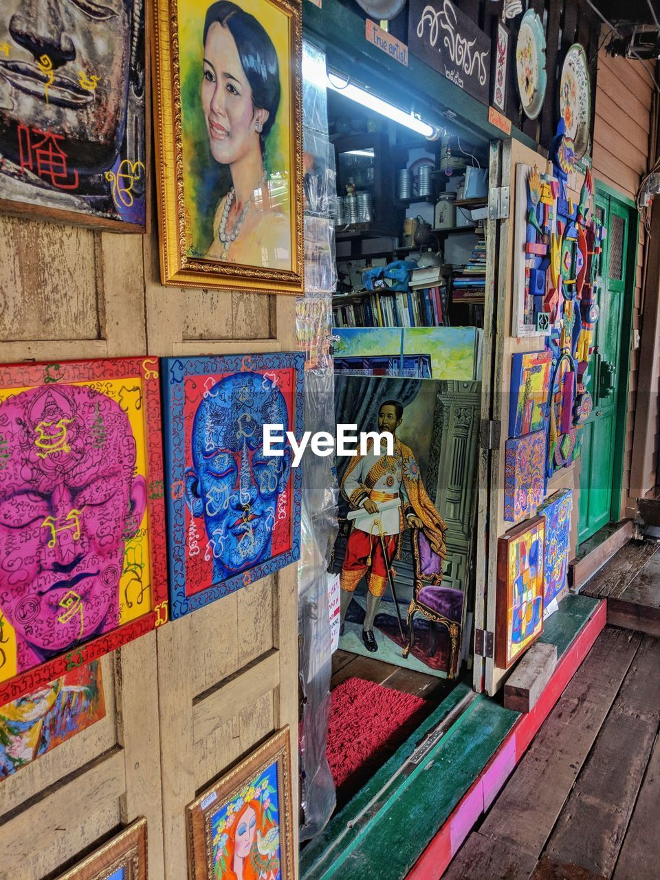 multi colored, human representation, choice, variation, art and craft, no people, representation, creativity, indoors, female likeness, retail, male likeness, large group of objects, glass - material, store, illuminated, night, graffiti, arts culture and entertainment, abundance, vending machine