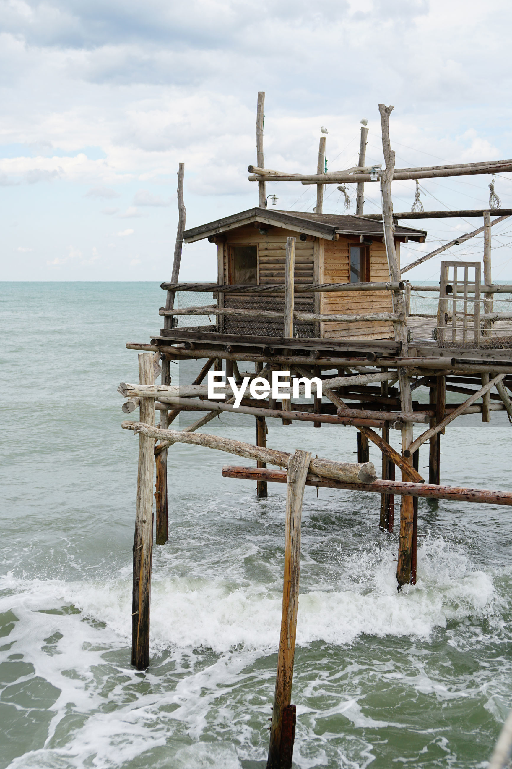 BUILT STRUCTURE ON SEA AGAINST SKY