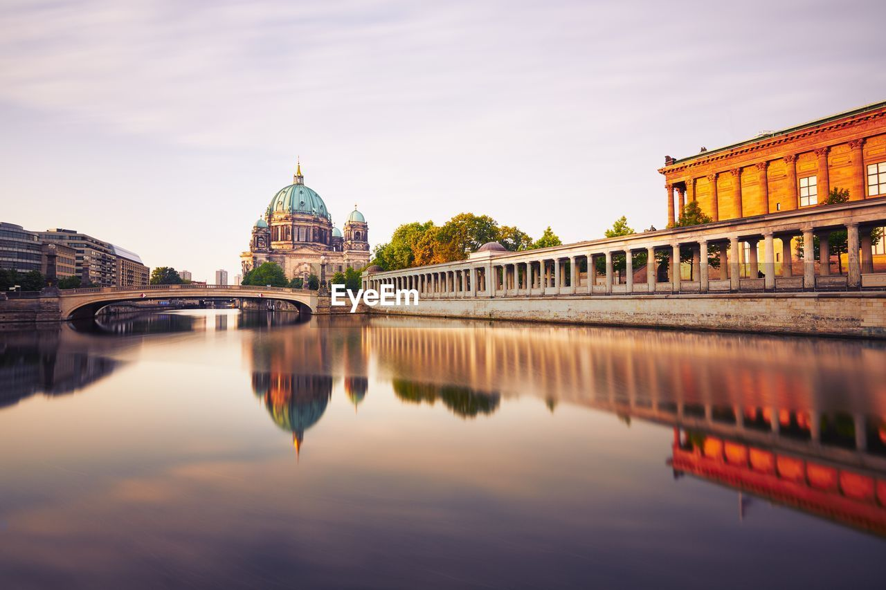 Berlin cathedral by river against sky