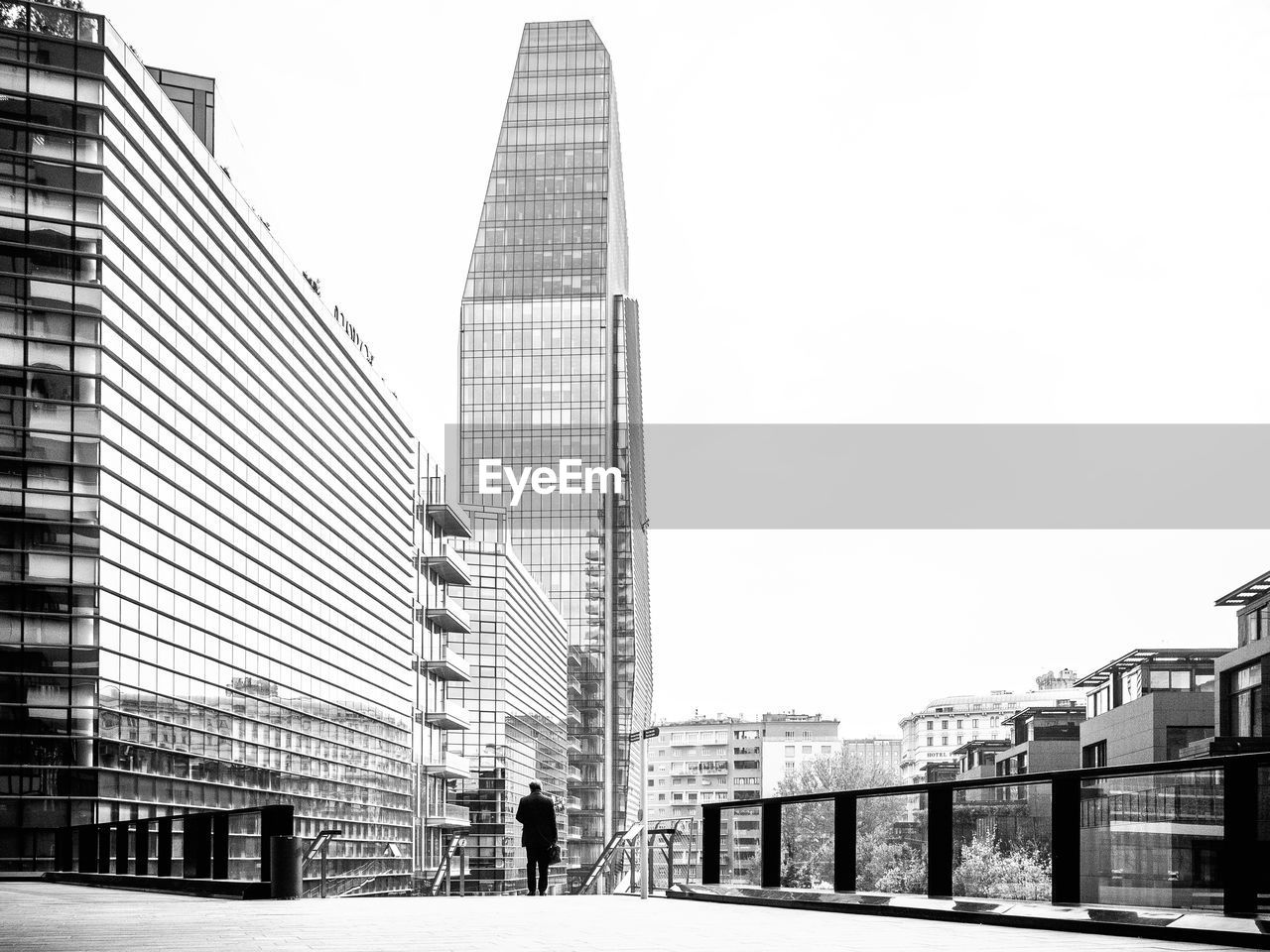 architecture, building exterior, built structure, skyscraper, city, modern, city life, outdoors, day, real people, sky, travel destinations, clear sky, cityscape