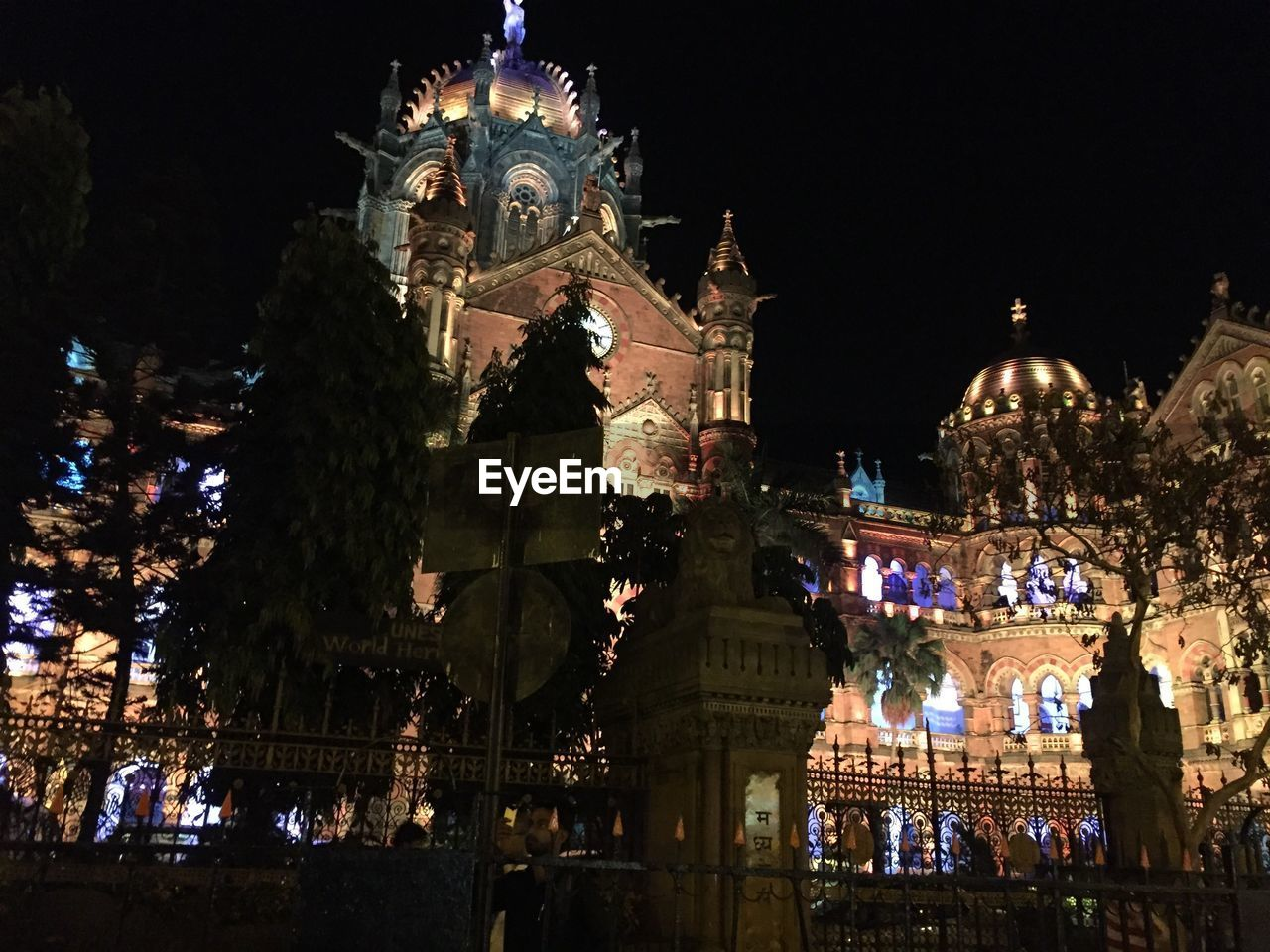night, illuminated, building exterior, architecture, celebration, built structure, large group of people, tradition, christmas, low angle view, christmas lights, christmas decoration, outdoors, real people, sky, tree, city, crowd, people