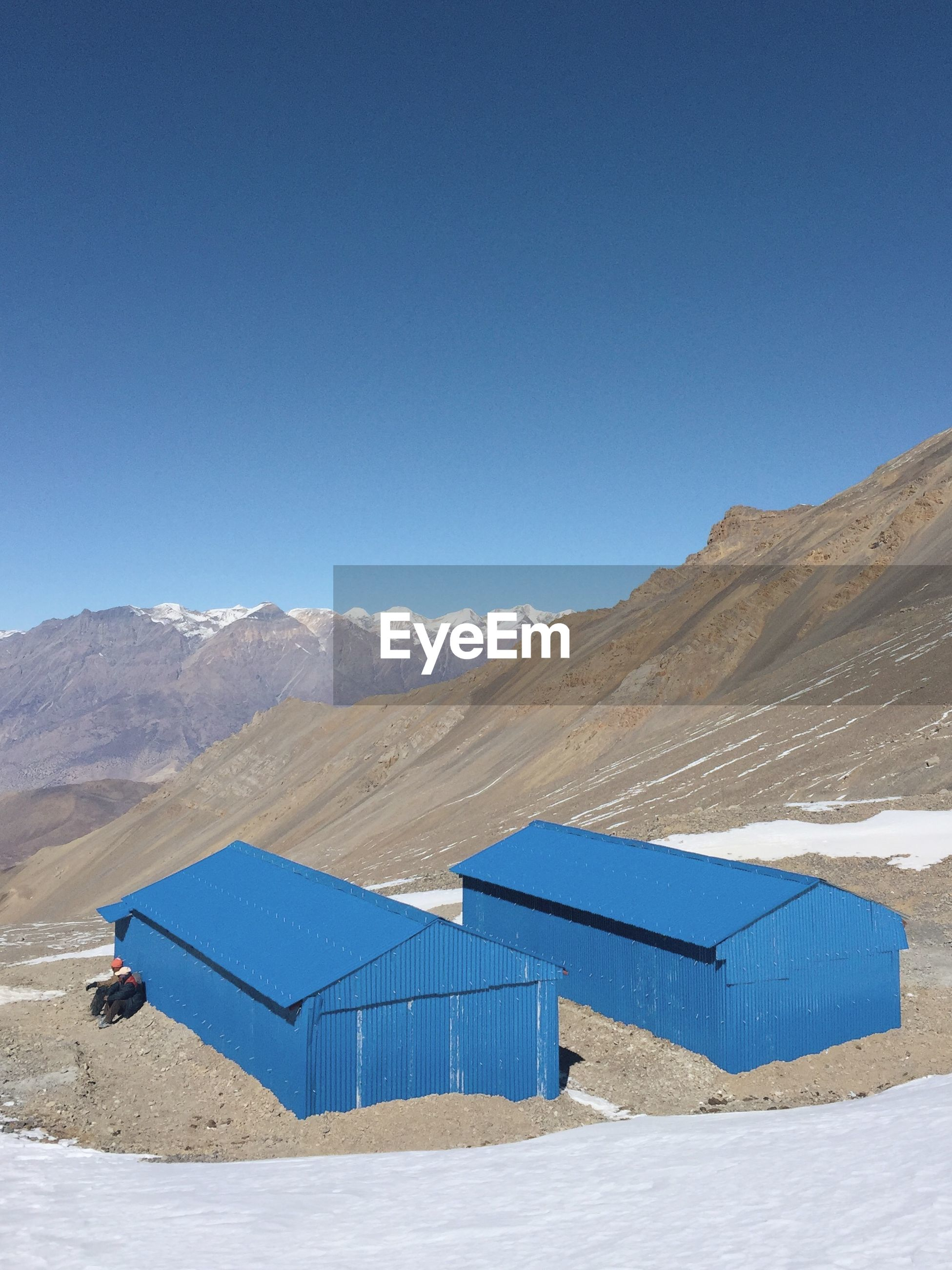 Scenic view of annapurna range against clear blue sky