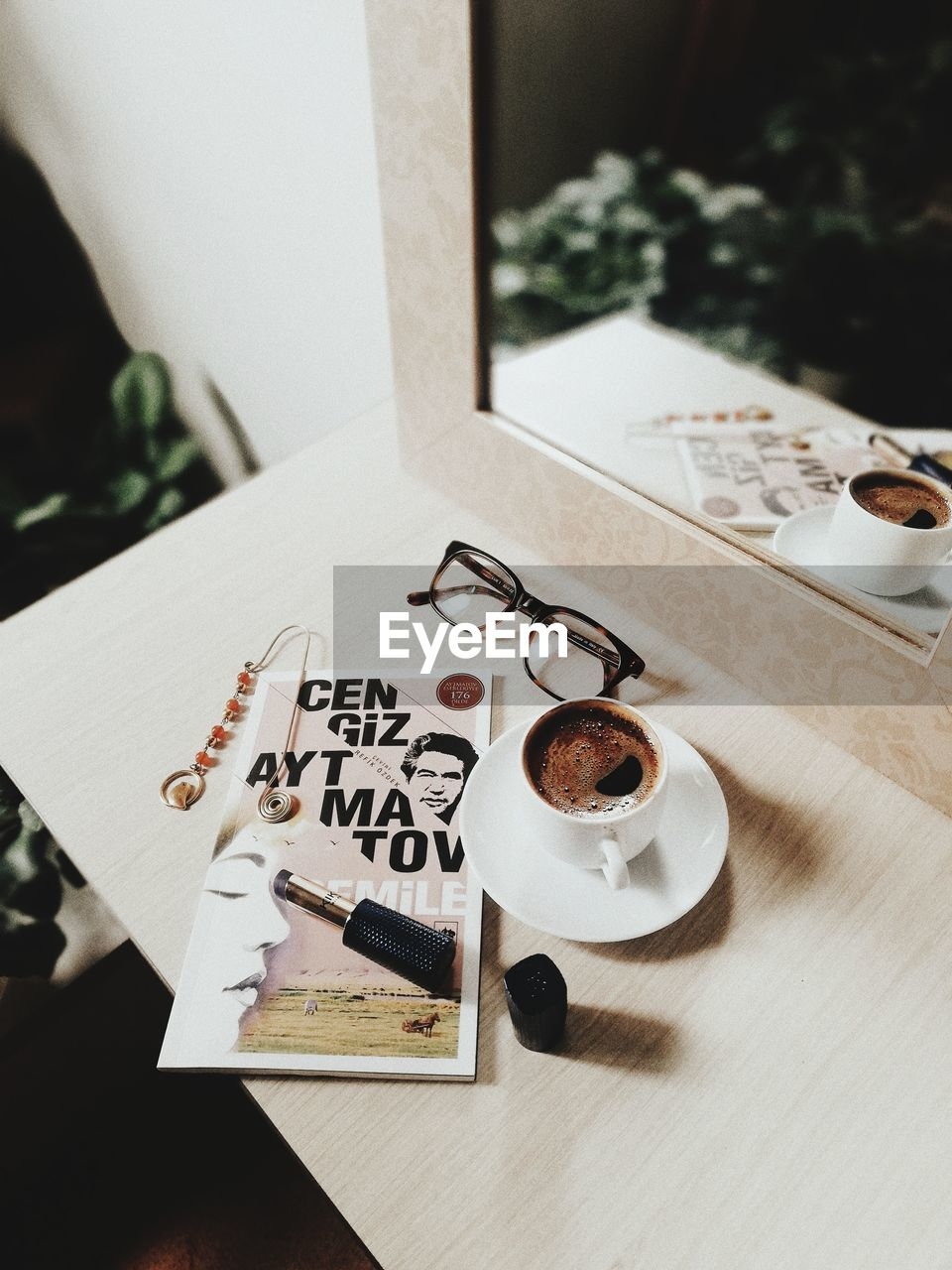 HIGH ANGLE VIEW OF TEXT ON COFFEE CUP