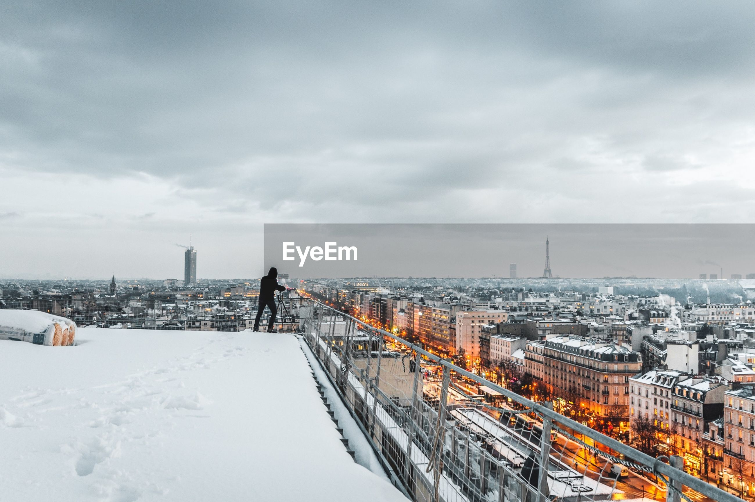 architecture, built structure, snow, sky, cityscape, weather, winter, cloud - sky, building exterior, city, cold temperature, outdoors, real people, day, nature, men, one person, people