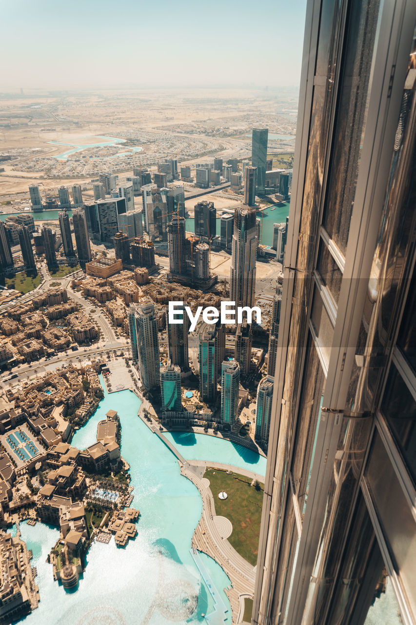 architecture, building exterior, built structure, cityscape, city, building, high angle view, nature, day, water, sky, no people, residential district, outdoors, travel destinations, skyscraper, modern, travel, office building exterior