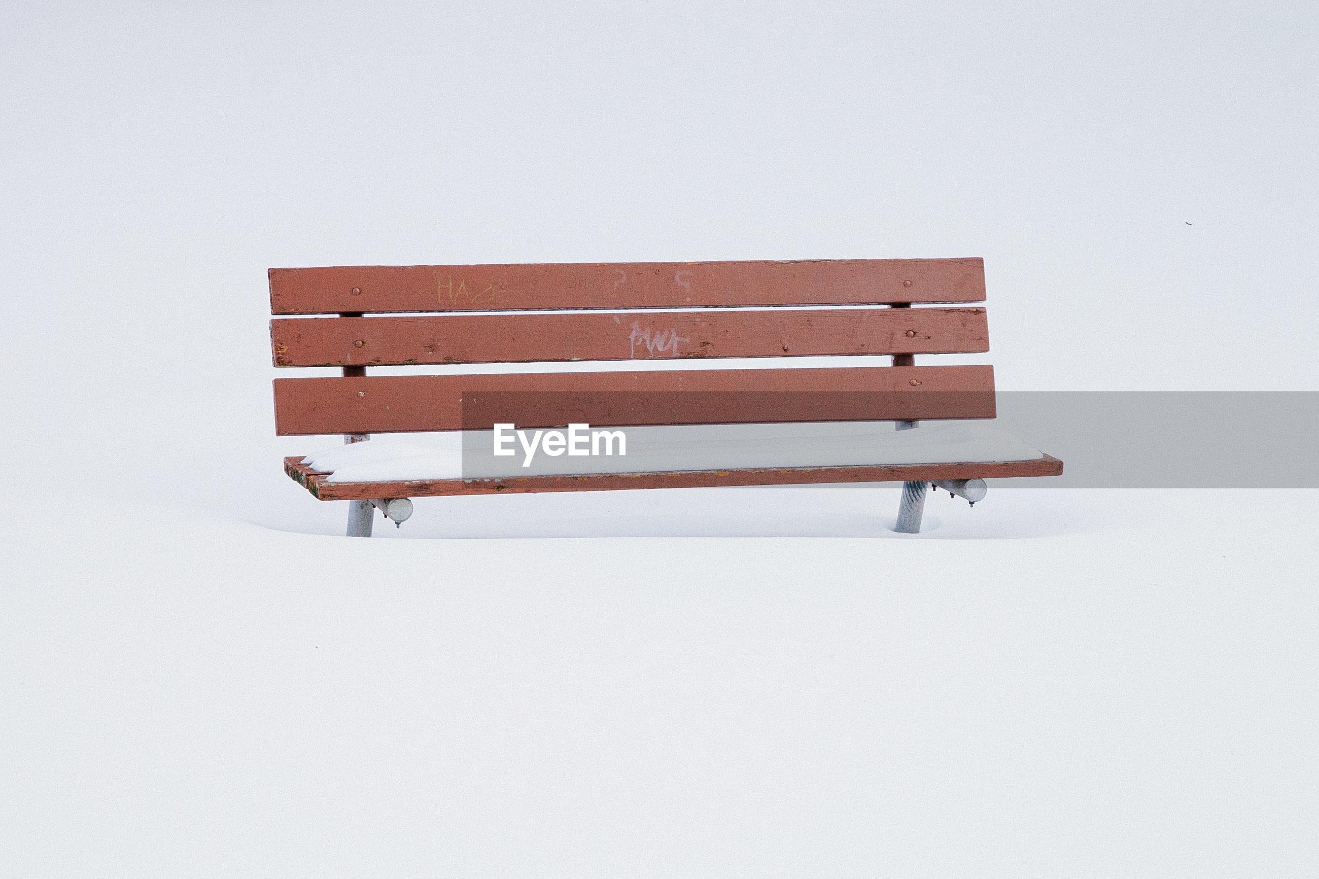 Empty bench on snow
