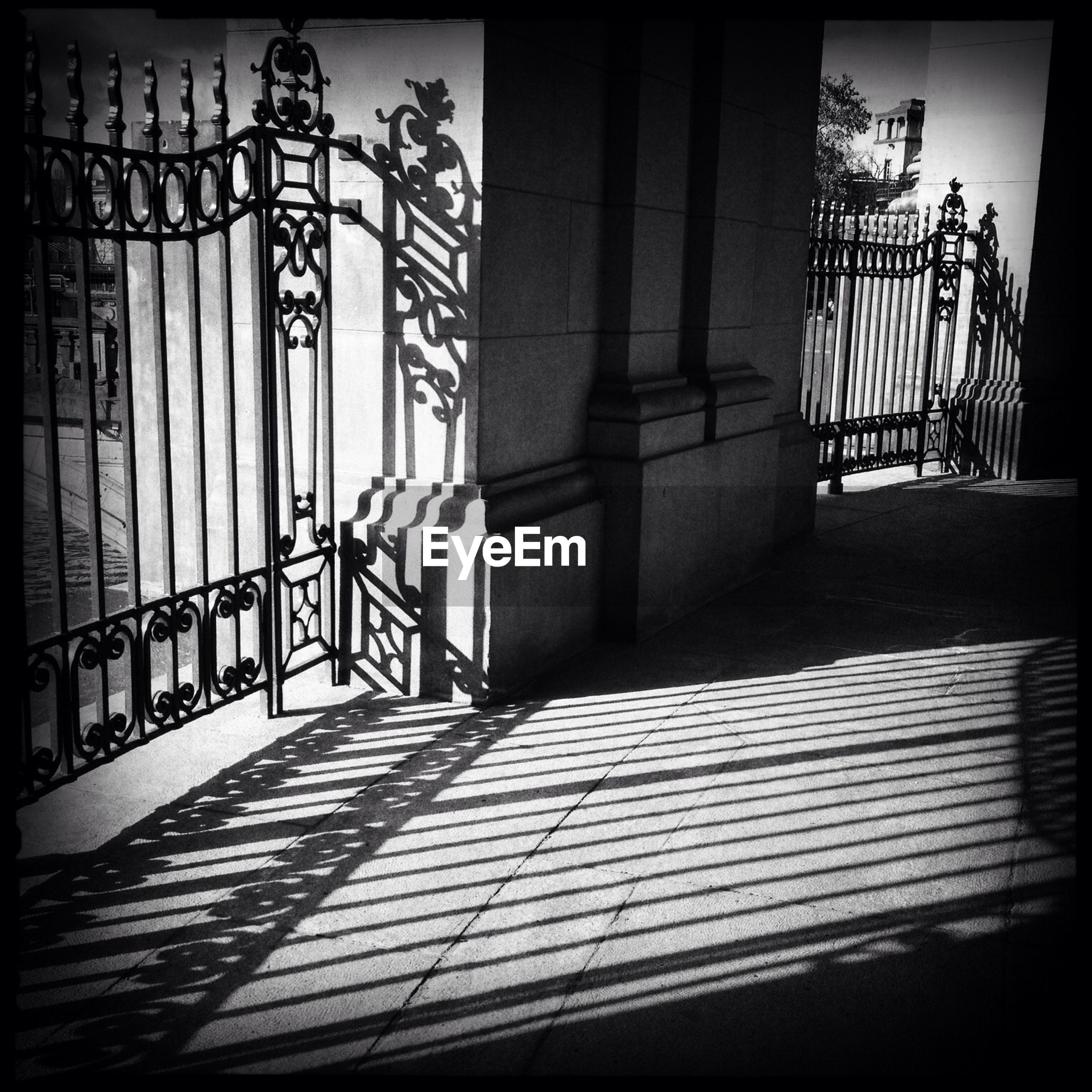 Shadow of gate falling on courtyard