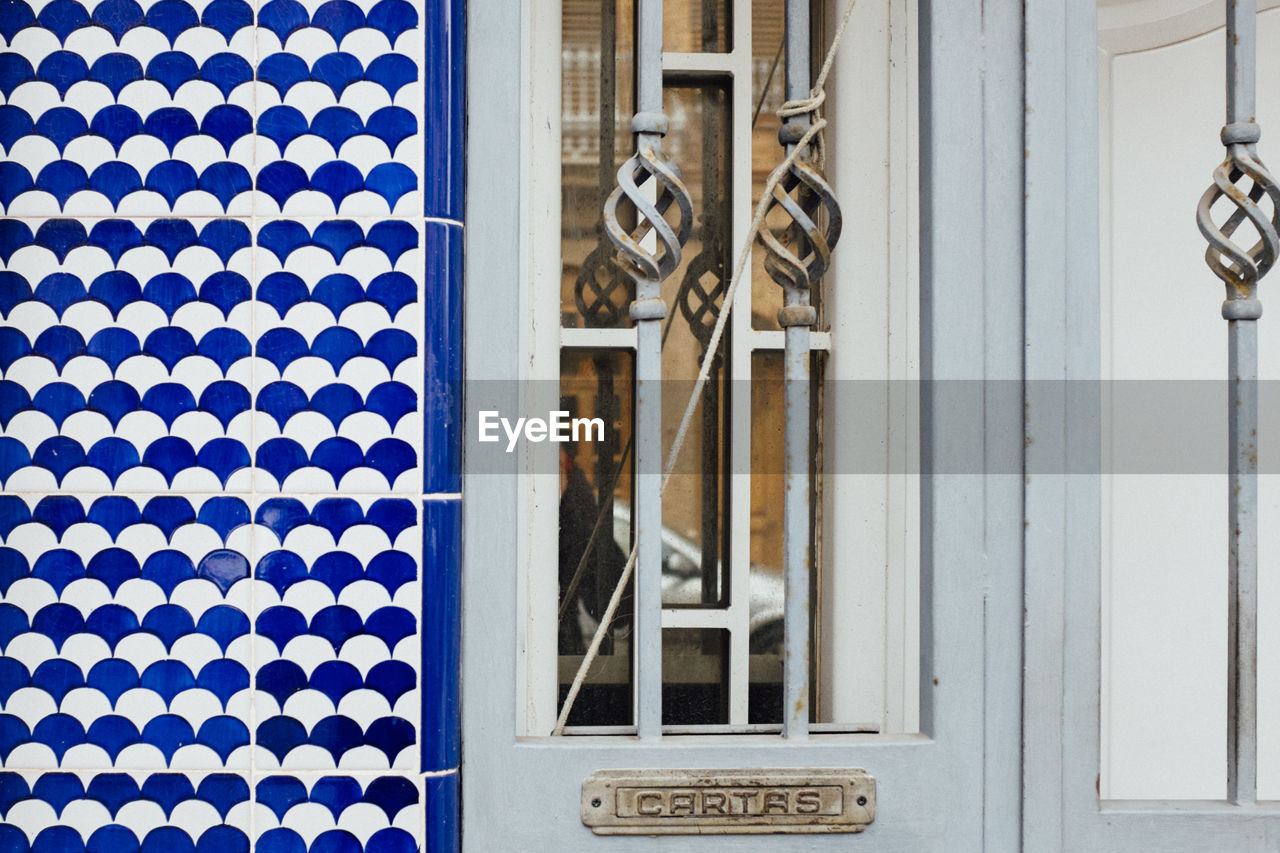 Close-up of door and patterned wall