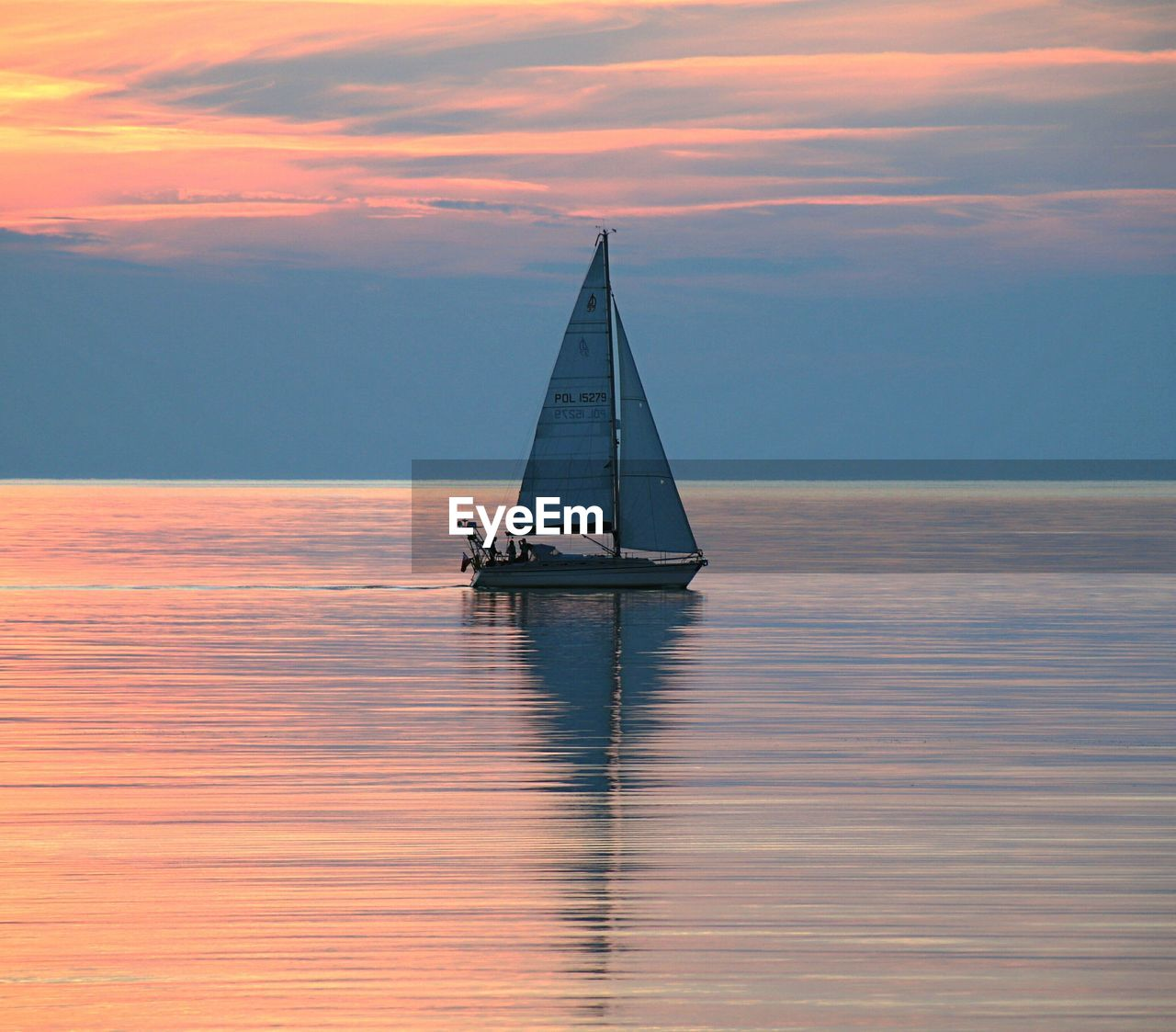 sunset, sea, water, sky, nature, beauty in nature, waterfront, tranquility, reflection, scenics, nautical vessel, transportation, tranquil scene, horizon over water, sailboat, outdoors, cloud - sky, no people, sailing, day
