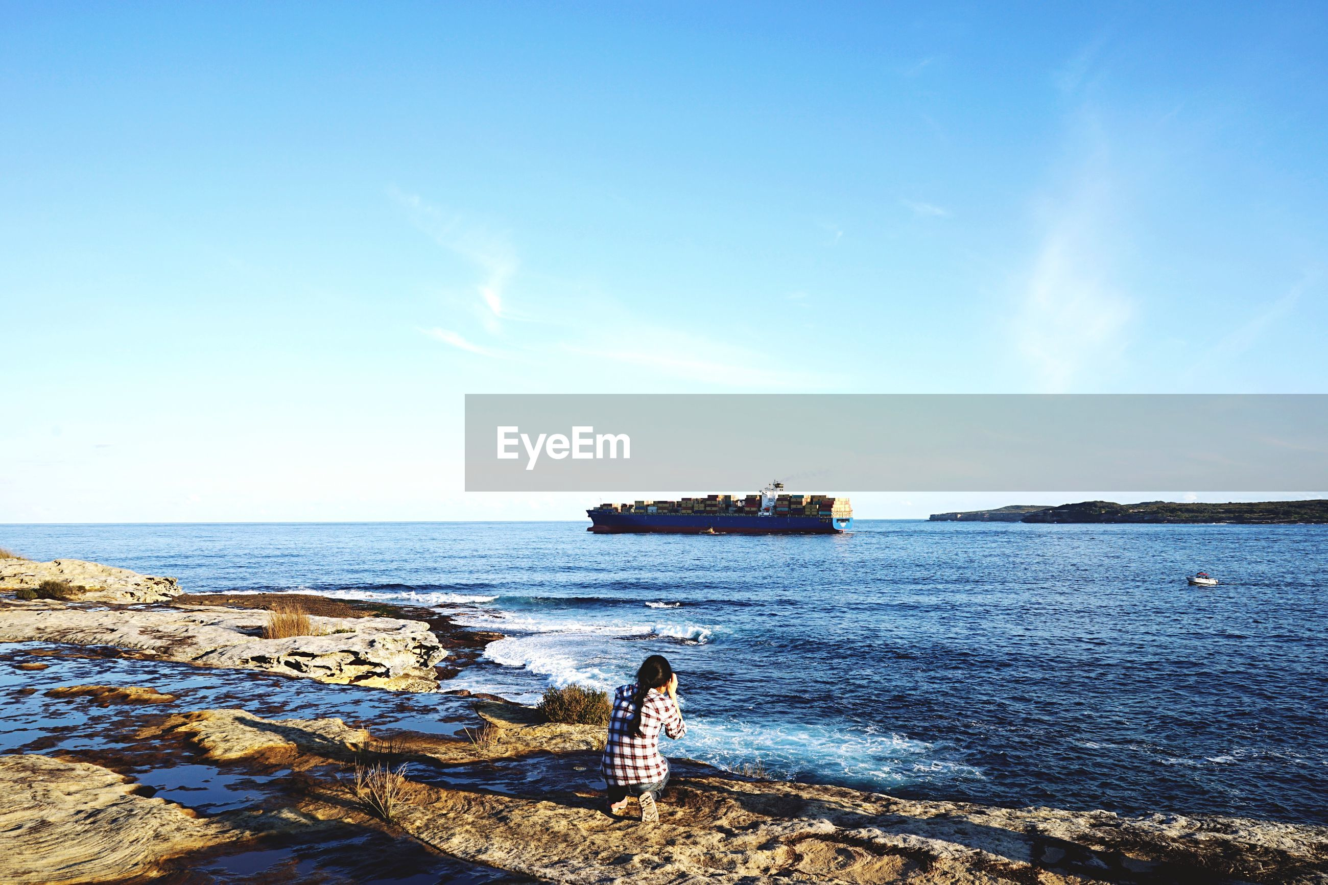sea, water, horizon over water, beach, tranquility, sky, tranquil scene, blue, nautical vessel, shore, scenics, transportation, beauty in nature, nature, mode of transport, boat, rock - object, sand, idyllic, sunlight