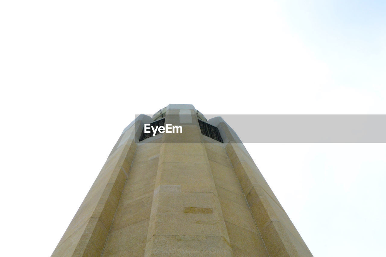 low angle view, copy space, no people, architecture, clear sky, built structure, day, outdoors, sky, white background, building exterior