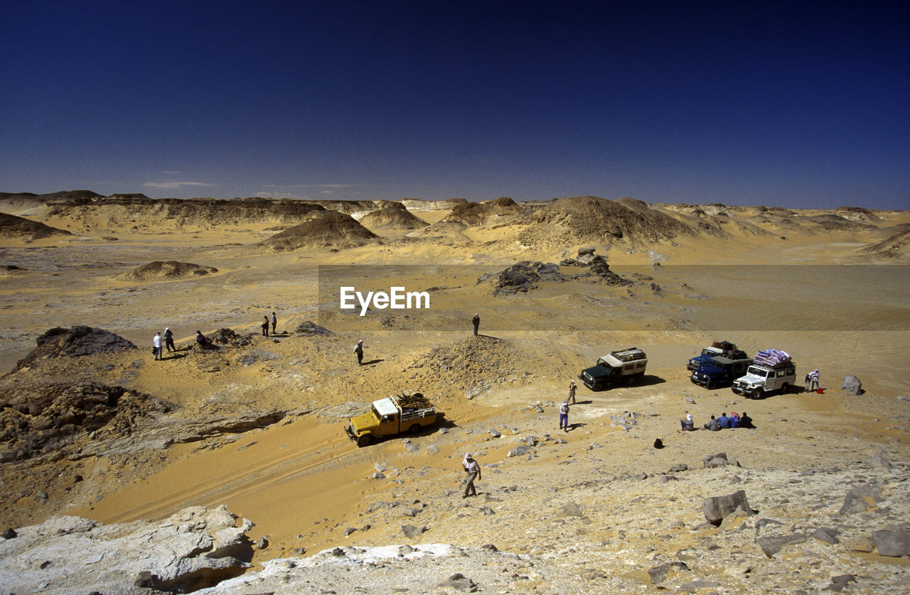 High Angle View Of Land Vehicles On Desert Landscape