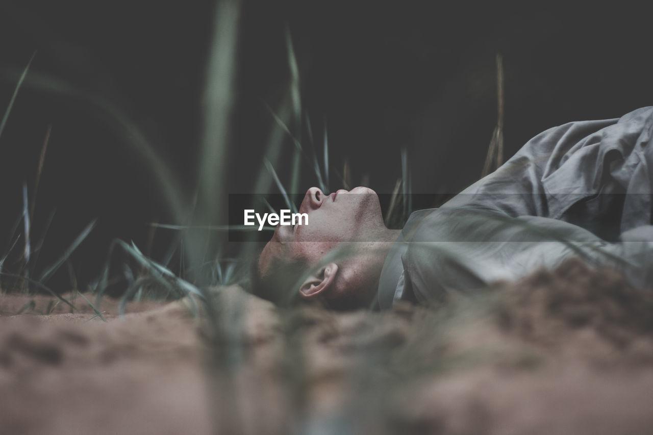 Man lying on field