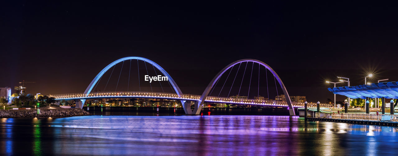 night, illuminated, water, bridge - man made structure, long exposure, connection, outdoors, waterfront, clear sky, motion, sky, architecture, no people, nature