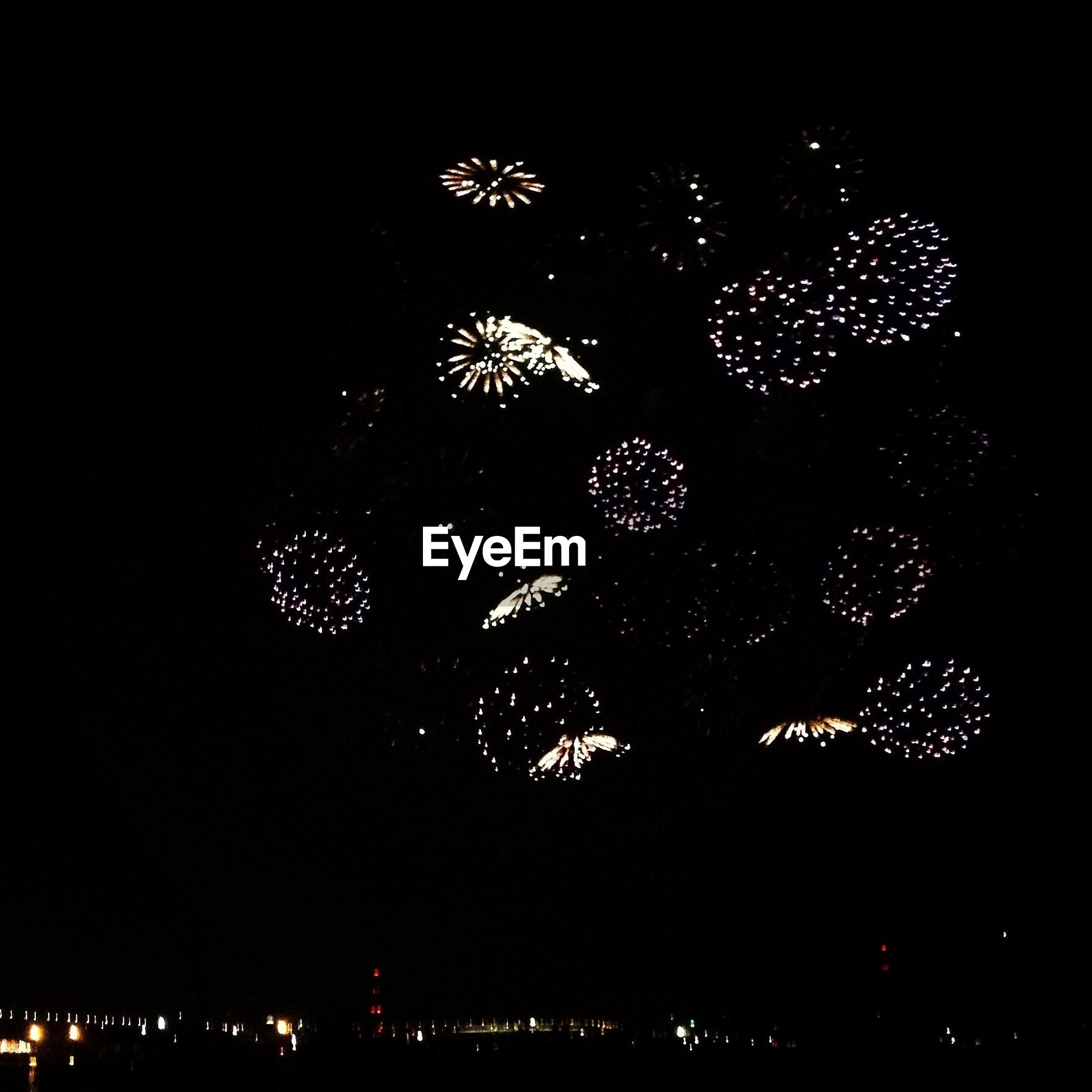 night, illuminated, arts culture and entertainment, celebration, firework display, low angle view, dark, glowing, sky, exploding, firework - man made object, built structure, city, lighting equipment, architecture, light, event, light - natural phenomenon, building exterior, long exposure