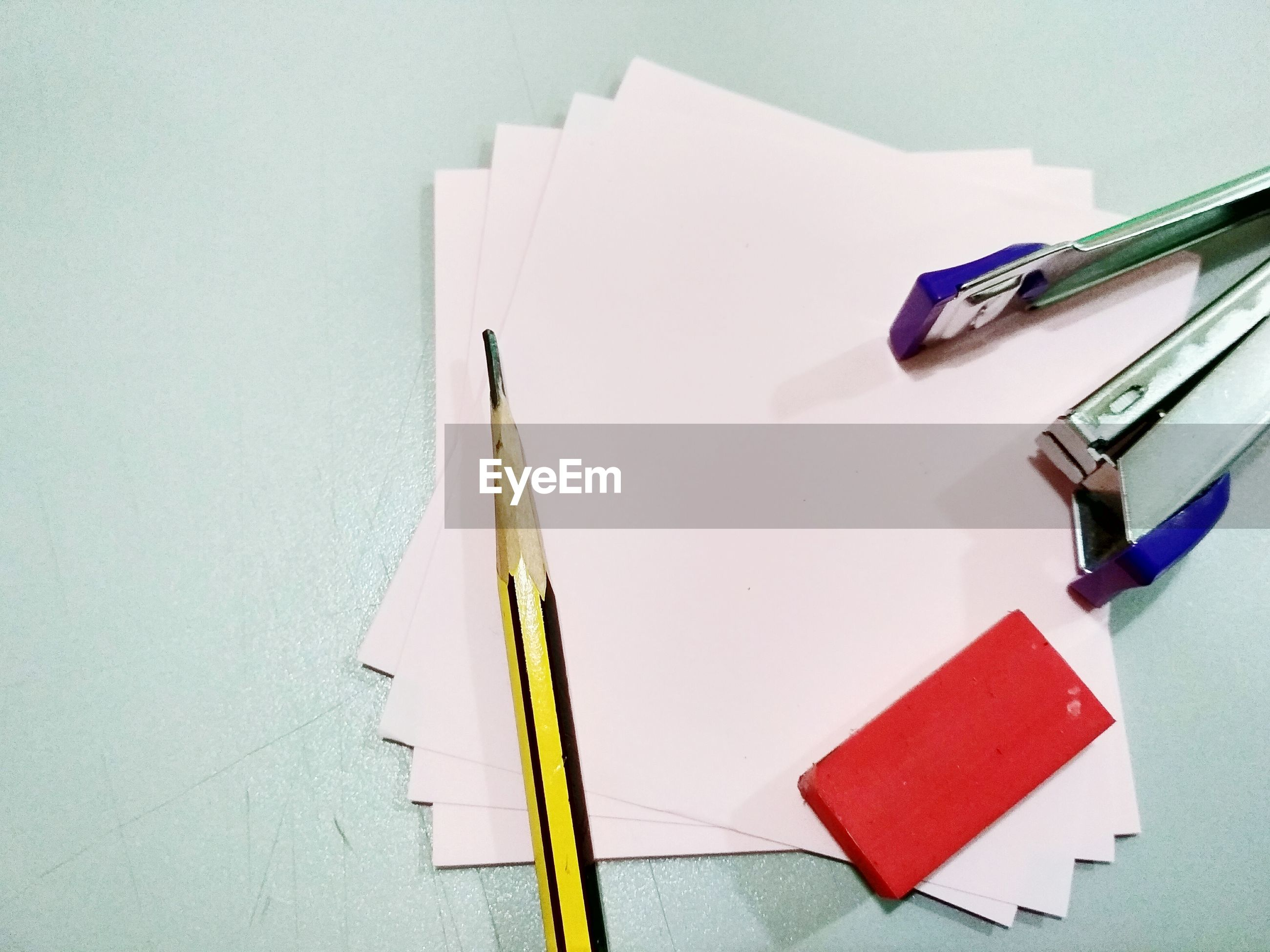 High angle view of office supply on table