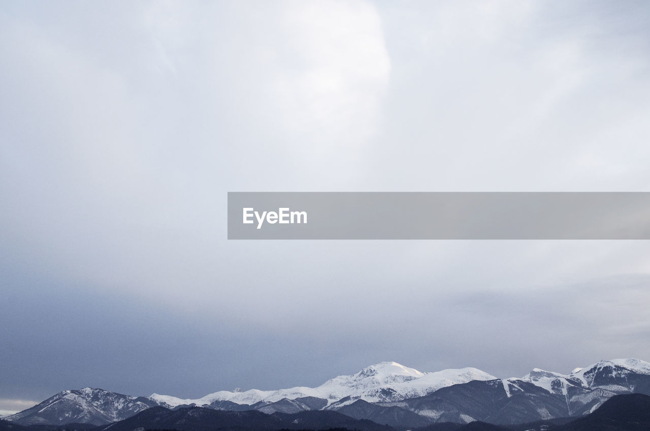 cold temperature, mountain, sky, beauty in nature, scenics - nature, winter, snow, tranquility, day, tranquil scene, environment, cloud - sky, no people, nature, landscape, mountain range, non-urban scene, snowcapped mountain, mountain peak, outdoors