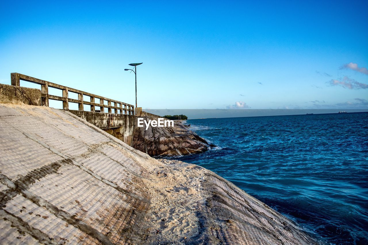 sea, water, horizon over water, blue, outdoors, nature, scenics, no people, beauty in nature, clear sky, tranquil scene, tranquility, day, sky