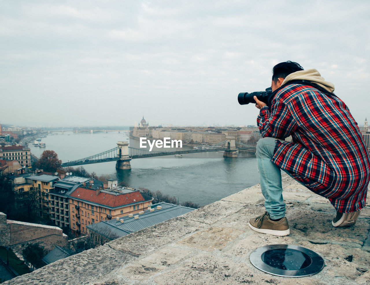 Man Photographing City By River