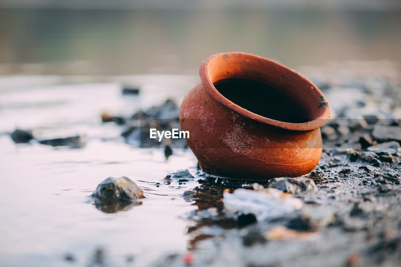 selective focus, food and drink, no people, close-up, focus on foreground, day, still life, brown, orange color, food, nature, outdoors, cold temperature, cup, freshness, coffee, table, winter, water