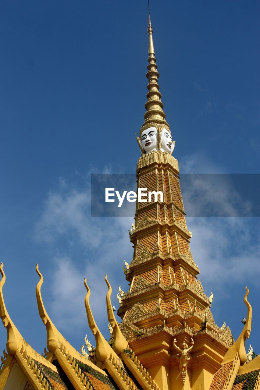 religion, spirituality, place of worship, architecture, gold colored, pagoda, building exterior, travel destinations, low angle view, sky, built structure, gold, blue, travel, history, statue, cloud - sky, outdoors, day, no people, sculpture