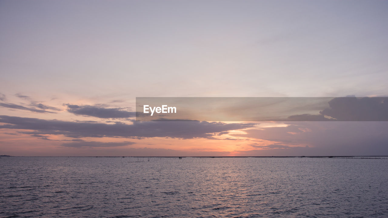 sky, water, sunset, horizon, beauty in nature, sea, tranquility, horizon over water, scenics - nature, cloud - sky, tranquil scene, waterfront, no people, idyllic, nature, orange color, outdoors, remote, non-urban scene