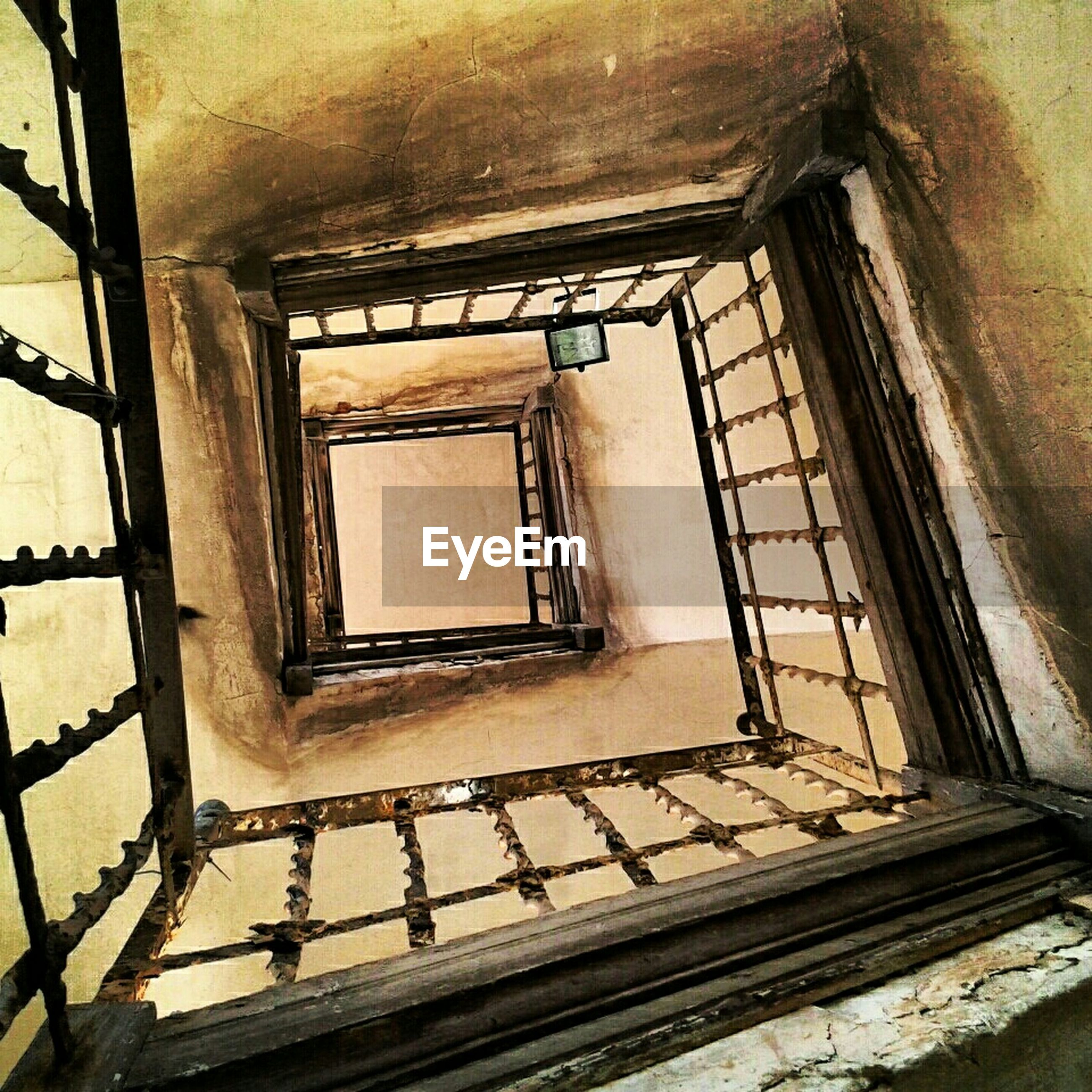 indoors, steps and staircases, staircase, steps, architecture, built structure, railing, window, ceiling, wall - building feature, building, low angle view, no people, house, stairs, home interior, spiral staircase, day, sunlight, glass - material