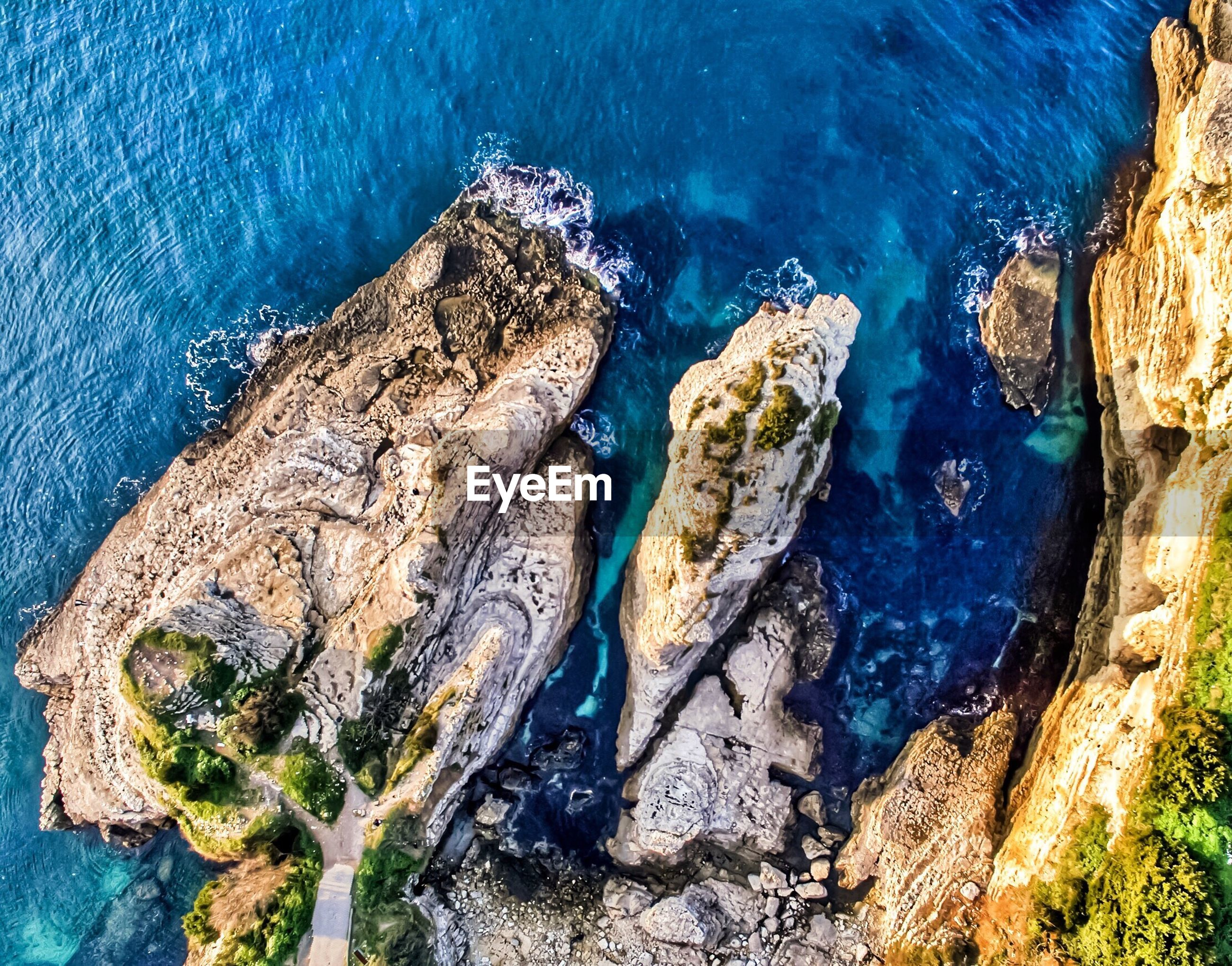 HIGH ANGLE VIEW OF SEA AND BLUE WATER