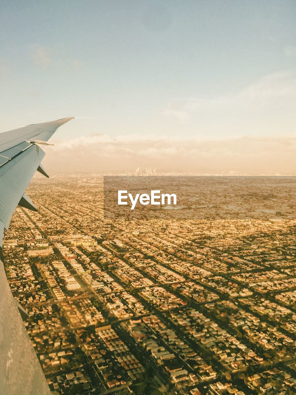 air vehicle, airplane, sky, transportation, mode of transportation, flying, cloud - sky, aircraft wing, landscape, nature, travel, mid-air, beauty in nature, aerial view, environment, no people, scenics - nature, sunset, outdoors, journey, plane