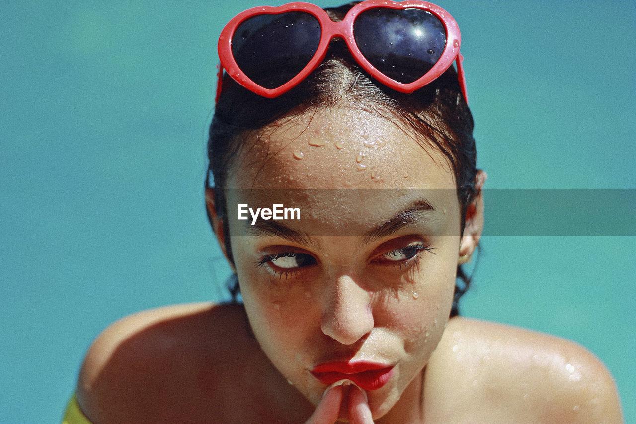 Close-up of thoughtful teenage girl in swimming pool