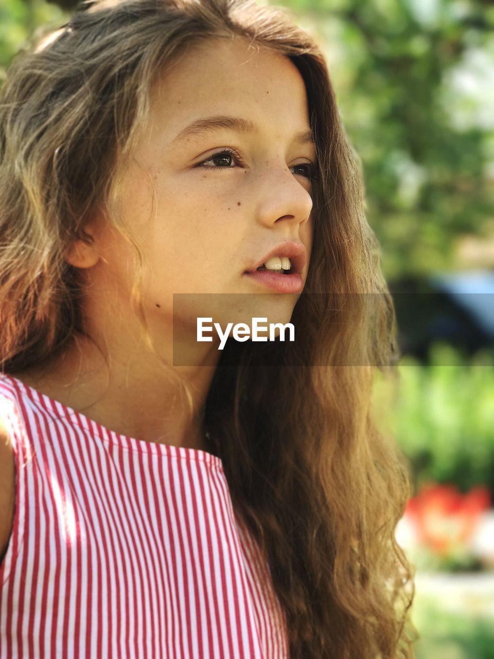 Close-up of teenage girl looking away