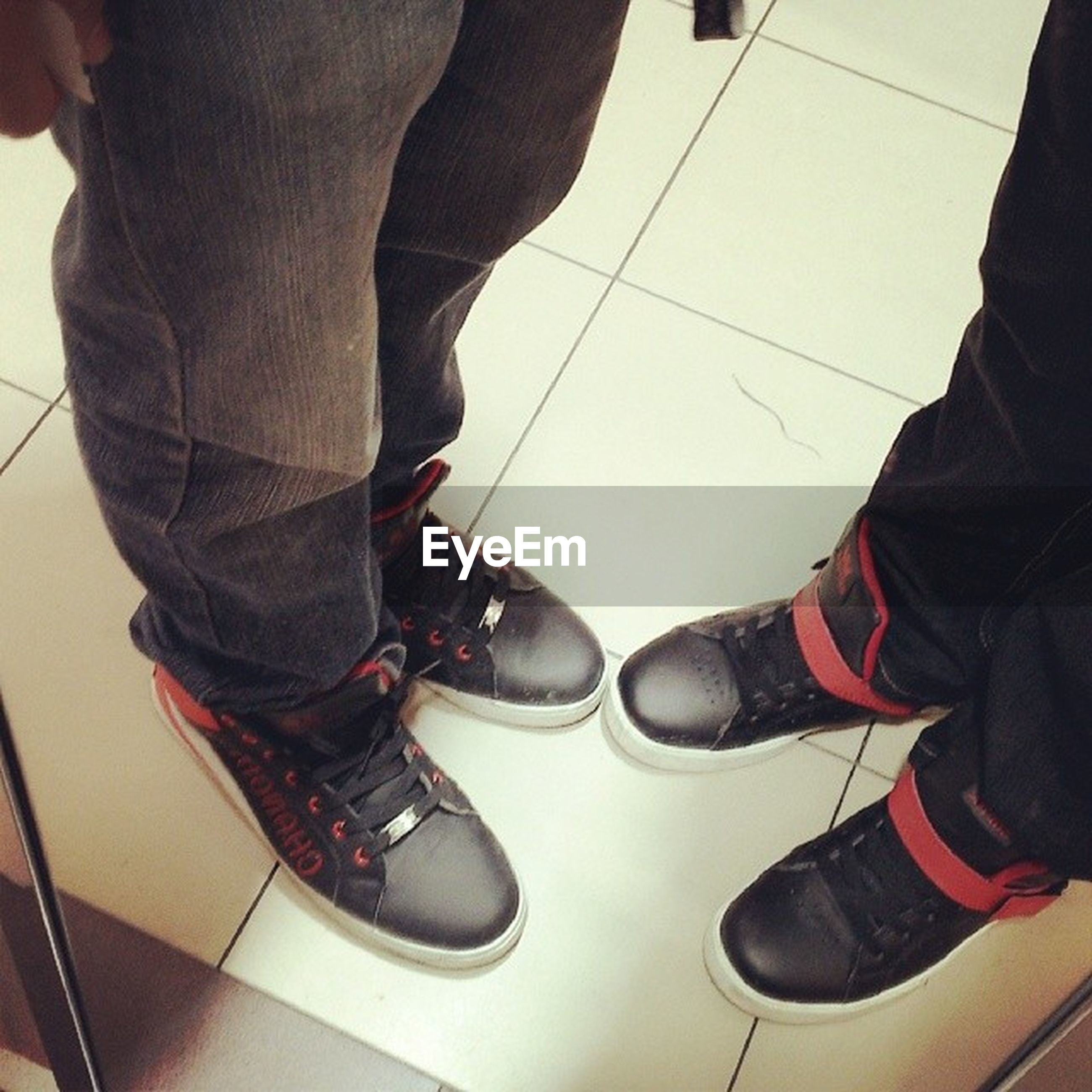 low section, person, indoors, men, shoe, standing, lifestyles, human foot, high angle view, footwear, casual clothing, leisure activity, part of, jeans, sitting